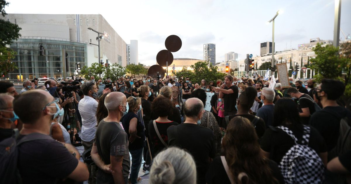 Dozens of pro-democracy protesters rally against Netanyahu government in Tel Aviv