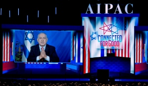 Benjamin Netanyahu speaks on a video from Israel to the 2019 AIPAC policy conference, March 26, 2019.